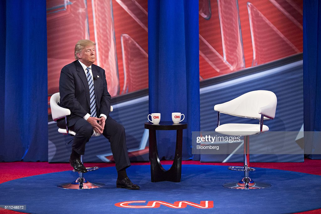 Donald Trump, president and chief executive of Trump Organization Inc. and 2016 Republican presidential candidate, sits on stage during a commercial break at a town hall event hosted by CNN at the University of South Carolina in Columbia, South Carolina, U.S., on Wednesday, Feb. 17, 2016. Trump remains the front-runner in South Carolina, where Republican voters head to the polls on Saturday. According to a survey released Monday by Democratic pollster Public Policy Polling, Trump holds a 17-point lead over Senators Marco Rubio and Ted Cruz, who are tied for second place. Photographer: Daniel Acker/Bloomberg via Getty Images