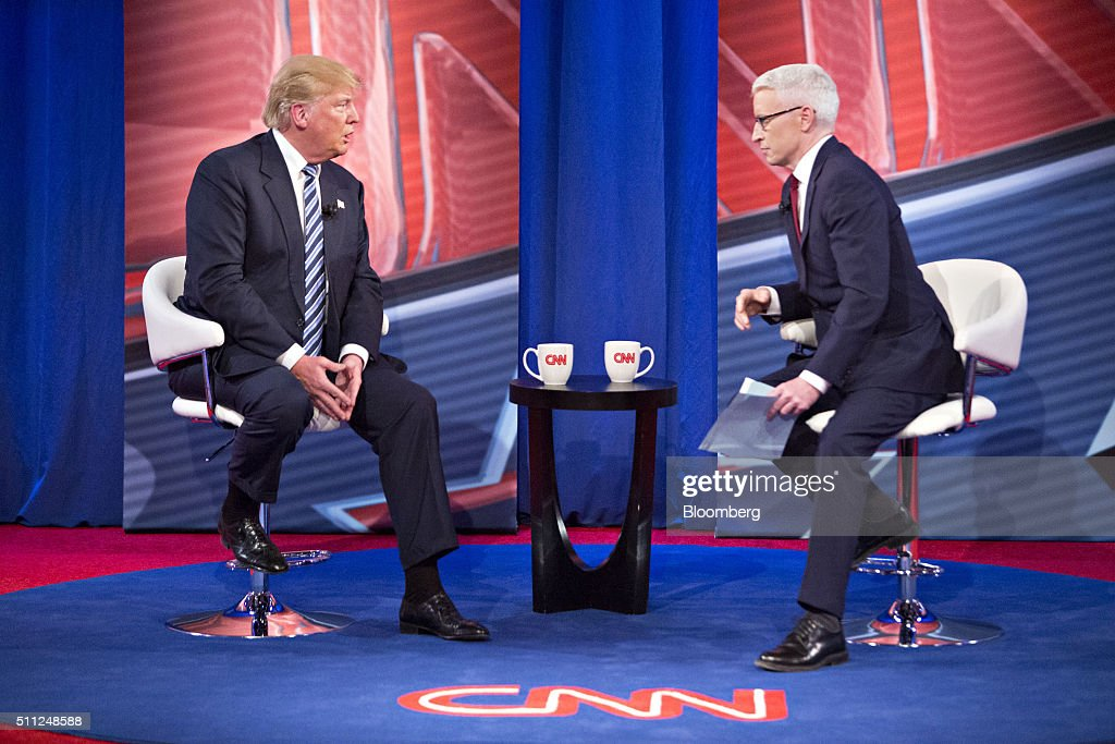 Donald Trump, president and chief executive of Trump Organization Inc. and 2016 Republican presidential candidate, left, speaks with anchor Anderson Cooper during a town hall event hosted by CNN at the University of South Carolina in Columbia, South Carolina, U.S., on Wednesday, Feb. 17, 2016. Trump remains the front-runner in South Carolina, where Republican voters head to the polls on Saturday. According to a survey released Monday by Democratic pollster Public Policy Polling, Trump holds a 17-point lead over Senators Marco Rubio and Ted Cruz, who are tied for second place. Photographer: Daniel Acker/Bloomberg via Getty Images
