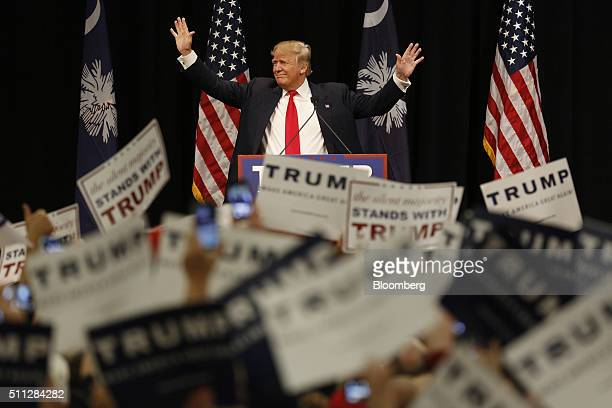 Donald Trump president and chief executive of Trump Organization Inc and 2016 Republican presidential candidate acknowledges cheering audience...