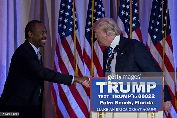 Donald Trump president and chief executive of Trump Organization Inc and 2016 Republican presidential candidate right shakes hands with Ben Carson...