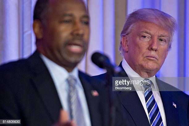 Donald Trump president and chief executive of Trump Organization Inc and 2016 Republican presidential candidate right looks on as Ben Carson retired...