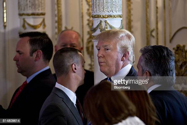 Donald Trump president and chief executive of Trump Organization Inc and 2016 Republican presidential candidate stands off to the side as Ben Carson...