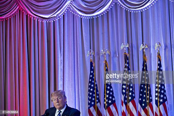 Donald Trump president and chief executive of Trump Organization Inc and 2016 Republican presidential candidate listens to a question during a news...