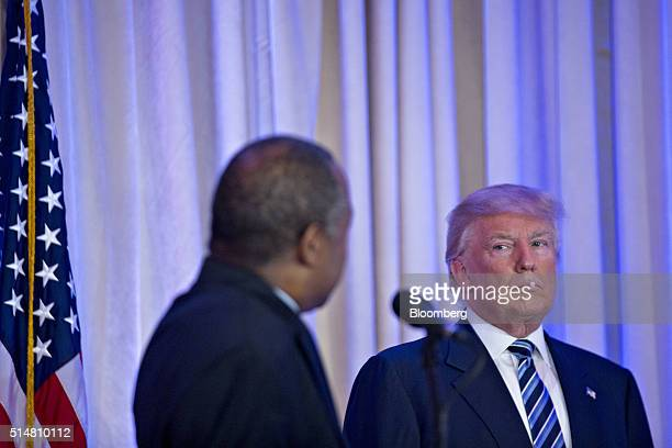 Donald Trump president and chief executive of Trump Organization Inc and 2016 Republican presidential candidate right looks towards Ben Carson...