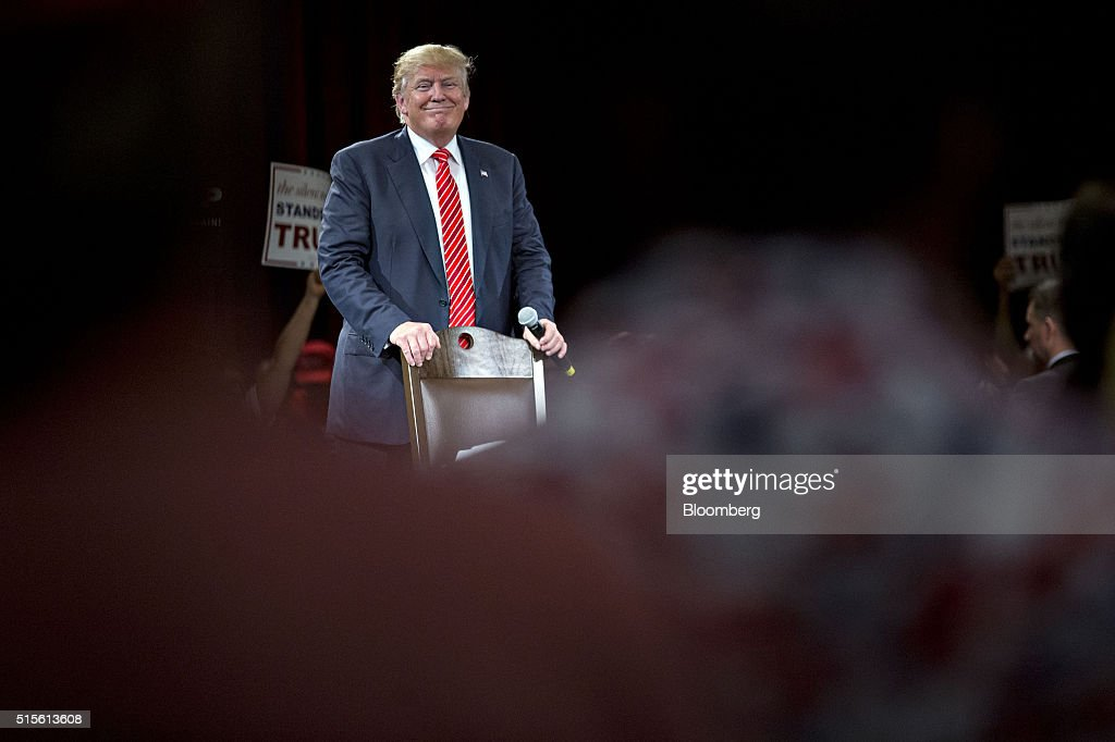 Donald Trump, president and chief executive of Trump Organization Inc. and 2016 Republican presidential candidate, smiles while listening to a question during a town hall event at the Tampa Convention Center in Tampa, Florida, U.S., on Monday, March 14, 2016. As protesters shadow campaign appearances by Trump, the billionaire has shifted a planned Monday-night rally in south Florida to Ohio, where polls show Governor John Kasich may be pulling ahead days before the states primary election. Photographer: Andrew Harrer/Bloomberg via Getty Images