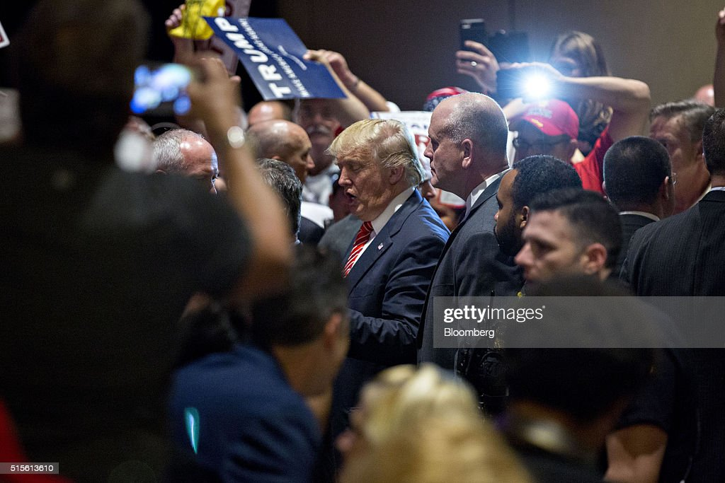 Donald Trump, president and chief executive of Trump Organization Inc. and 2016 Republican presidential candidate, greets attendees after speaking during a town hall event at the Tampa Convention Center in Tampa, Florida, U.S., on Monday, March 14, 2016. As protesters shadow campaign appearances by Trump, the billionaire has shifted a planned Monday-night rally in south Florida to Ohio, where polls show Governor John Kasich may be pulling ahead days before the states primary election. Photographer: Andrew Harrer/Bloomberg via Getty Images