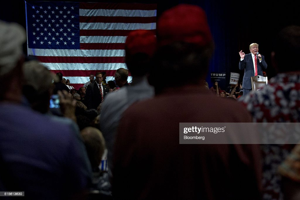 Donald Trump, president and chief executive of Trump Organization Inc. and 2016 Republican presidential candidate, right, speaks during a town hall event at the Tampa Convention Center in Tampa, Florida, U.S., on Monday, March 14, 2016. As protesters shadow campaign appearances by Trump, the billionaire has shifted a planned Monday-night rally in south Florida to Ohio, where polls show Governor John Kasich may be pulling ahead days before the states primary election. Photographer: Andrew Harrer/Bloomberg via Getty Images