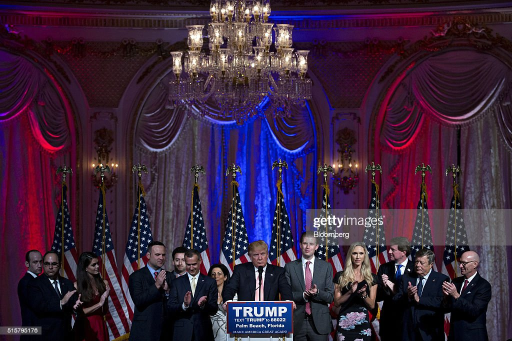 Donald Trump, president and chief executive of Trump Organization Inc. and 2016 Republican presidential candidate, center, pauses while speaking during a news conference with his son Eric Trump, center right, and Corey Lewandowski, campaign manager for Trump, center left, at the Mar-A-Lago Club in Palm Beach, Florida, U.S., on Tuesday, March 15, 2016. Billionaire Trump fell short of his goal of winning the two key states he needed to clear most of the Republican presidential field, securing a huge victory in Florida to knock out Senator Marco Rubio while losing Ohio to Governor John Kasich. Photographer: Andrew Harrer/Bloomberg via Getty Images