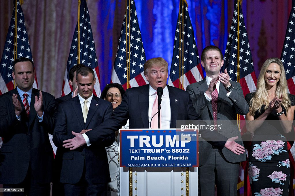 Donald Trump, president and chief executive of Trump Organization Inc. and 2016 Republican presidential candidate, center, speaks during a news conference with his son Eric Trump, second right, and Corey Lewandowski, campaign manager for Trump, second left, at the Mar-A-Lago Club in Palm Beach, Florida, U.S., on Tuesday, March 15, 2016. Billionaire Trump fell short of his goal of winning the two key states he needed to clear most of the Republican presidential field, securing a huge victory in Florida to knock out Senator Marco Rubio while losing Ohio to Governor John Kasich. Photographer: Andrew Harrer/Bloomberg via Getty Images