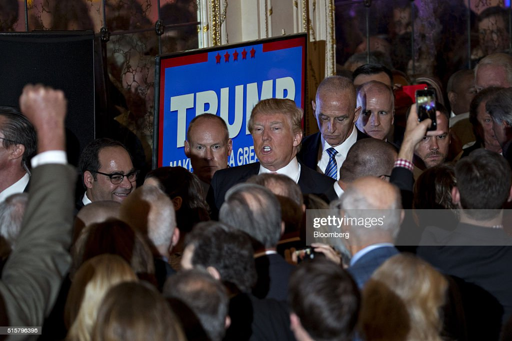 Donald Trump, president and chief executive of Trump Organization Inc. and 2016 Republican presidential candidate, center, exits after speaking at a news conference at the Mar-A-Lago Club in Palm Beach, Florida, U.S., on Tuesday, March 15, 2016. Billionaire Trump fell short of his goal of winning the two key states he needed to clear most of the Republican presidential field, securing a huge victory in Florida to knock out Senator Marco Rubio while losing Ohio to Governor John Kasich. Photographer: Andrew Harrer/Bloomberg via Getty Images