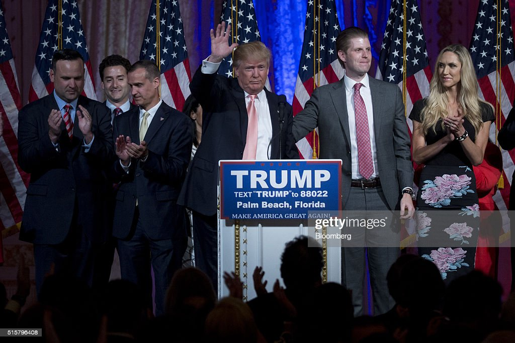 Donald Trump, president and chief executive of Trump Organization Inc. and 2016 Republican presidential candidate, center, waves after speaking during a news conference at the Mar-A-Lago Club in Palm Beach, Florida, U.S., on Tuesday, March 15, 2016. Billionaire Trump fell short of his goal of winning the two key states he needed to clear most of the Republican presidential field, securing a huge victory in Florida to knock out Senator Marco Rubio while losing Ohio to Governor John Kasich. Photographer: Andrew Harrer/Bloomberg via Getty Images