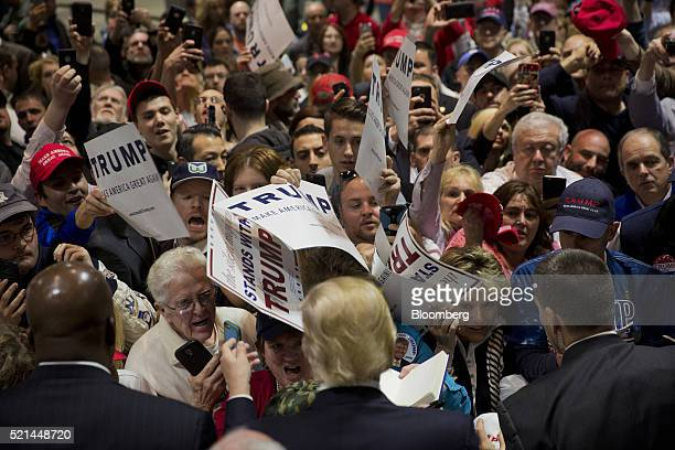 Donald Trump president and chief executive of Trump Organization Inc and 2016 Republican presidential candidate greets attendees during a campaign...