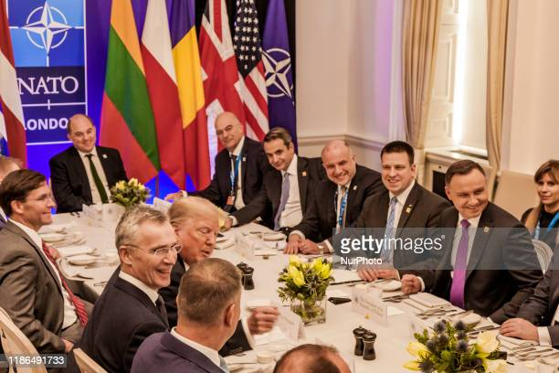 Donald Trump, President of the United States, and Jens Stoltenberg, Secretary General of NATO, left side, joking in a lunch meeting in the 70th...