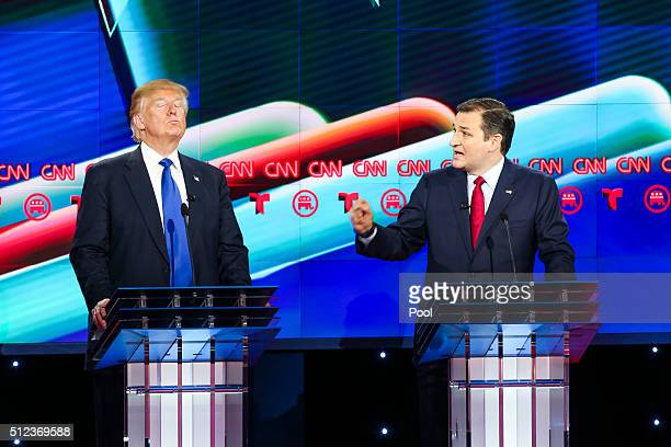 Donald Trump reacts as Sen Ted Cruz makes a point in the Republican presidential debate at the Moores School of Music at the University of Houston on...