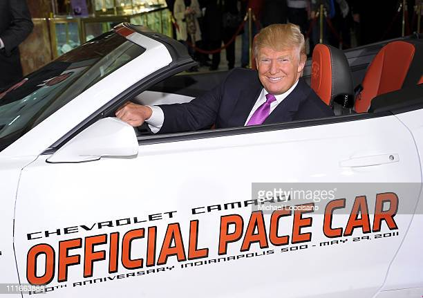 Donald Trump settles into his new ride as the 2011 Indianapolis 500 Chevrolet Camaro SS Convertible Pace Car driver for the 100th Anniversary of the...