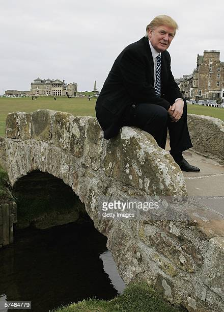 Donald Trump sits on the Swilken Burn bridge at the Old Course in St Andrews while meeting with the media to answer questions regarding Trump...