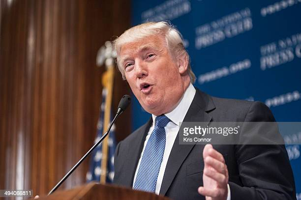 """Donald Trump speaks about building """"The Trump Brand"""" during a luncheon at The National Press Club on May 27, 2014 in Washington, DC."""