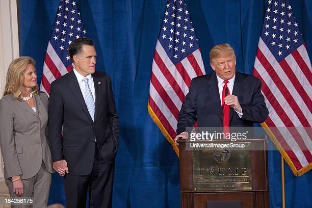 Donald Trump speaks at podium with Republican presidential candidate Mitt Romney after Trump endorsed Romneys presidential bid Feb 2 at the Trump...