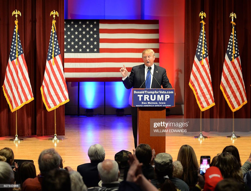 Donald Trump speaks during a campaign rally raising funds for US military veterans at Drake University in Des Moines, Iowa on January 28, 2016. US Republicans scrambling to win the first contest in the presidential nomination race were gearing for battle at high-profile debate in Iowa, but frontrunner Donald Trump is upending the campaign by defiantly refusing to attend. Trump's gamble has left the presidential race in uncharted waters just days before Iowans vote on February 1, insisting he will not back down in his feud with debate host Fox News.Instead, the billionaire has doubled down, hosting a rogue, rival event for US military veterans at the same time that his own party is showcasing its candidates for president to all-important Iowa voters. / AFP / William EDWARDS