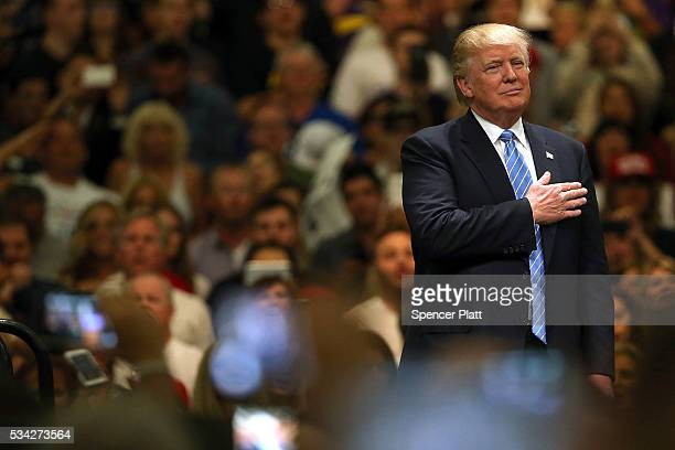 Donald Trump stands for the Pledge of Allegiance before speaking at a rally on May 25 2016 in Anaheim California The presumptive Republican...