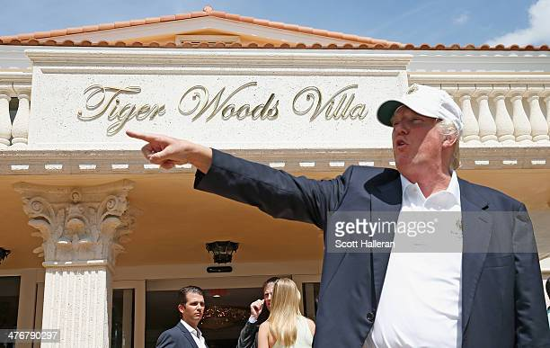 Donald Trump stands in front of the Tiger Woods Villa prior to the start of the World Golf ChampionshipsCadillac Championship at Trump National Doral...