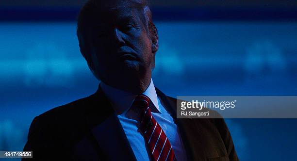 Donald Trump stands on stage during a break in the debate The CNBC Republican Presidential Debate is being held at the Coors Events Center at the...