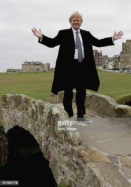 Donald Trump stands on the Swilken Burn bridge at the Old Course in St Andrews while meeting with the media to answer questions regarding Trump...