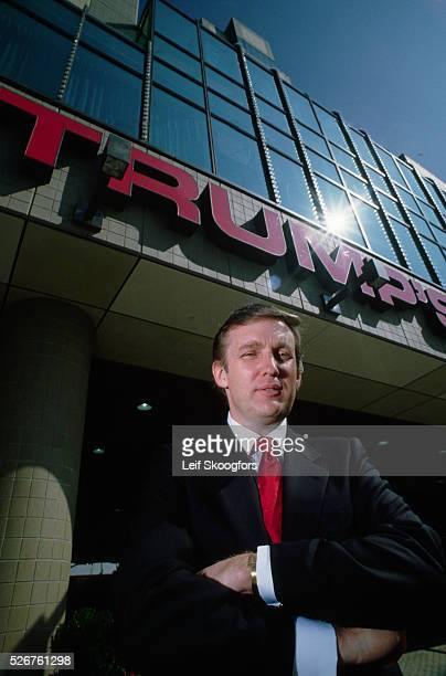 Donald Trump stands outside his first casino at its opening in Atlantic City New Jersey