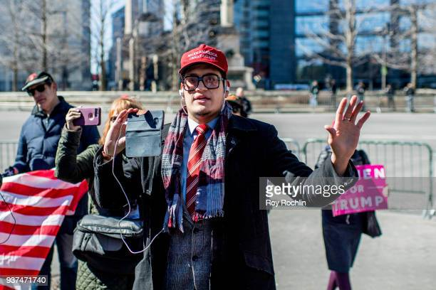 Donald Trump supporter counter protests during the March For Our Lives New York City to protest US gun laws on March 24 2018 in New York City