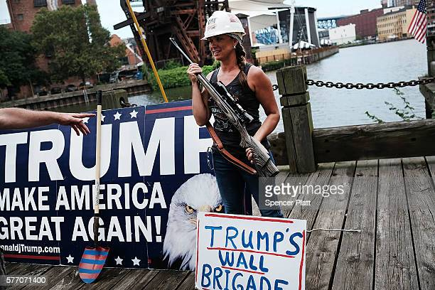 Donald Trump supporter poses with a gun while attending a rally for Trump on the first day of the Republican National Convention on July 18 2016 in...