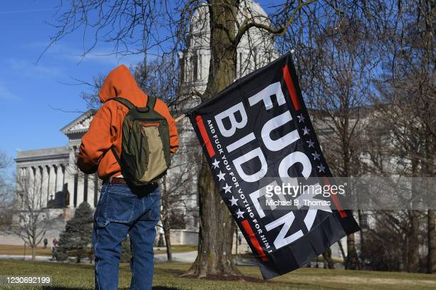 Donald Trump supporter waves a Anti-Biden flag outside the Missouri State Capitol building on January 20, 2021 in Jefferson City, Missouri....