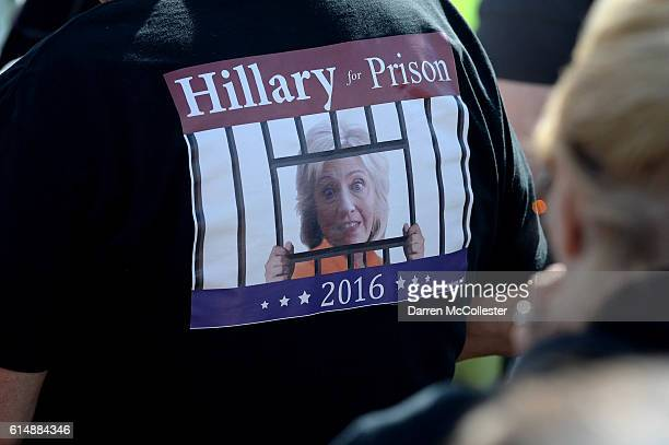 Donald Trump supporter wears a Hillary for Prison tshirt during a rally at Toyota Of Portsmouth on October 15 2016 in Portsmouth New Hampshire Trump...