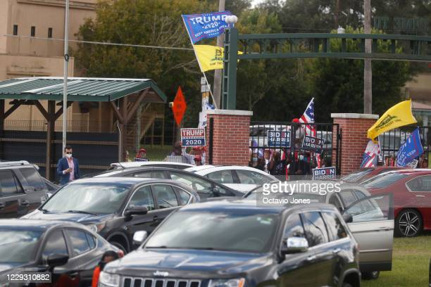 Donald Trump supporters are seen outside the gates while former President Barack Obama campaigns for Democratic presidential nominee Joe Biden at...