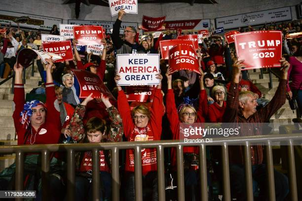 """Donald Trump supporters cheer during the President's """"Keep America Great"""" campaign rally at BancorpSouth Arena on November 1, 2019 in Tupelo,..."""
