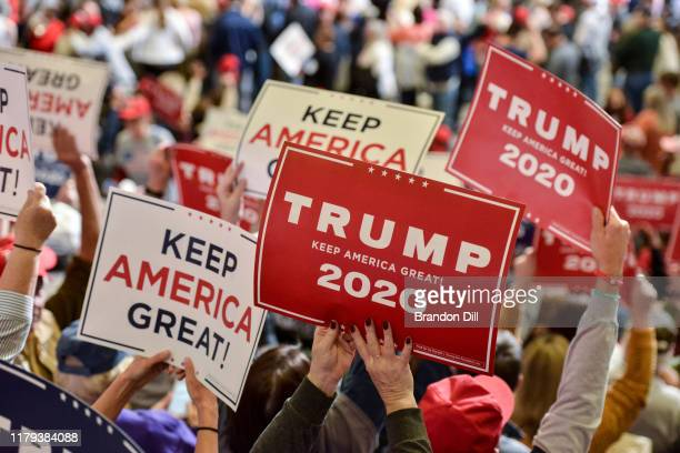 Donald Trump supporters cheer during the President's Keep America Great campaign rally at BancorpSouth Arena on November 1 2019 in Tupelo Mississippi...