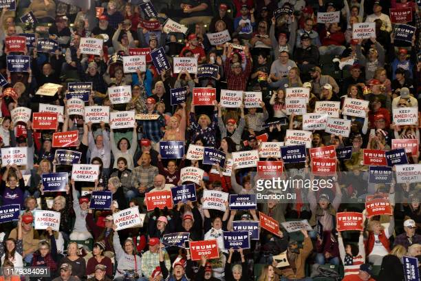 "Donald Trump supporters cheer during the President's ""Keep America Great"" campaign rally at BancorpSouth Arena on November 1, 2019 in Tupelo,..."