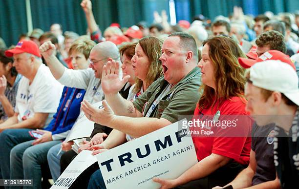 Donald Trump supporters cheer for their man inside Century II where the Republican presdential caucus took place in Wichita Kan on Saturday March 5...