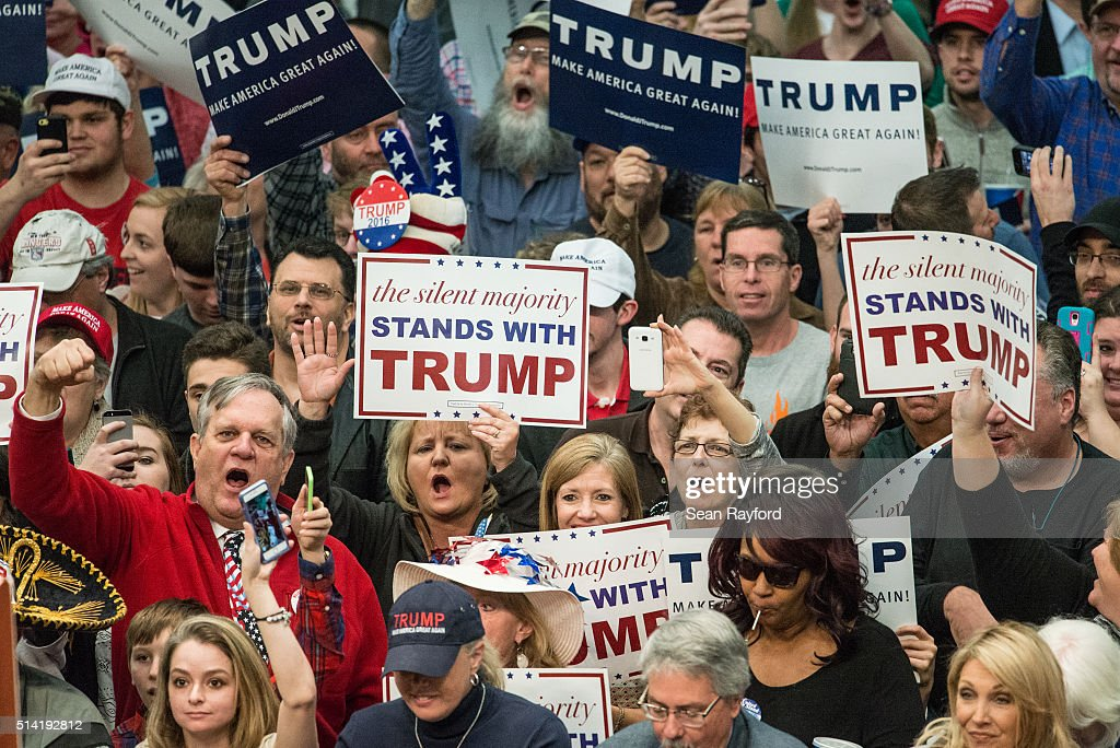 Donald Trump supporters cheer on the Republican presidential candidate before a campaign rally March 7, 2016 in Concord, North Carolina. The North Carolina Republican presidential primary will be held March 15.