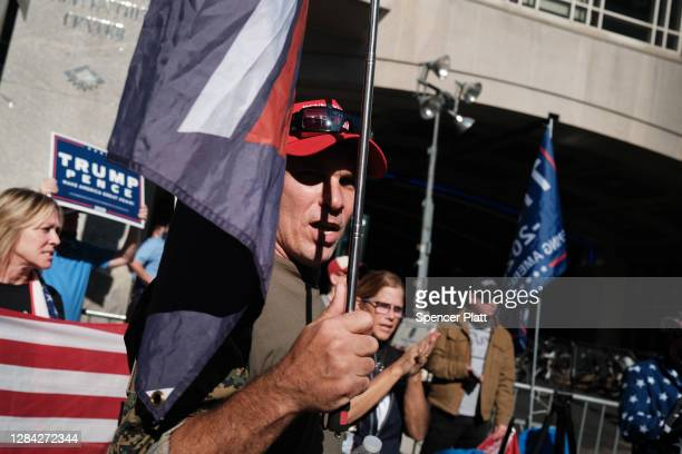 Donald Trump supporters converge outside of the Philadelphia Convention Center as the counting of ballots continues in the state on November 06, 2020...