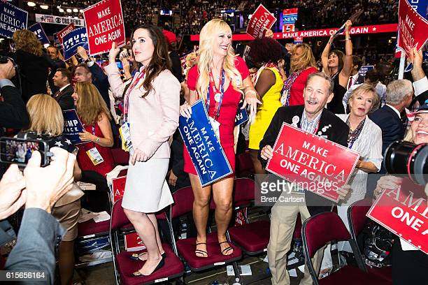 Donald Trump supporters dance to live music during the final night of the Republican National Convention on July 21 2016 at Quicken Loans Arena in...