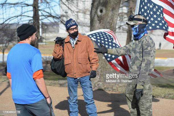 Donald Trump supporters debate a passing pedestrian outside the Missouri State Capitol building on January 20, 2021 in Jefferson City, Missouri....