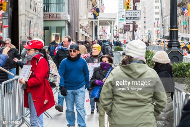 Donald Trump supporters found outside Manhattan Trump Tower holding flags and placards on January 27th 2017 in New York, United States Of America.