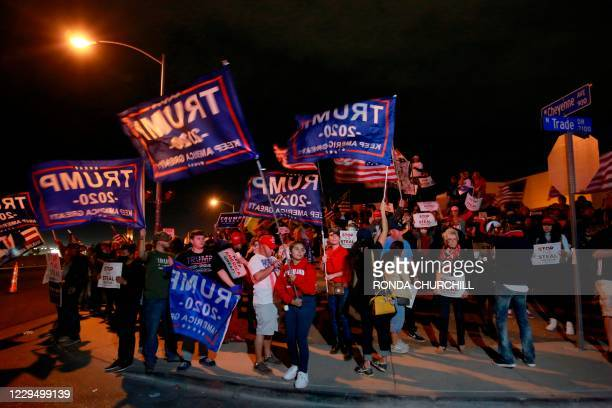 Donald Trump supporters protest outside Clark County Election Department where ballots are counted on November 6 in North Las Vegas. - President...