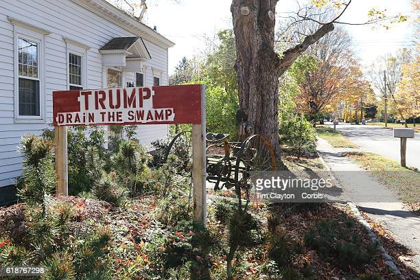 Donald Trump supporters sign in the garden of a home in the coastal town of Clinton Connecticut on October 26 2016