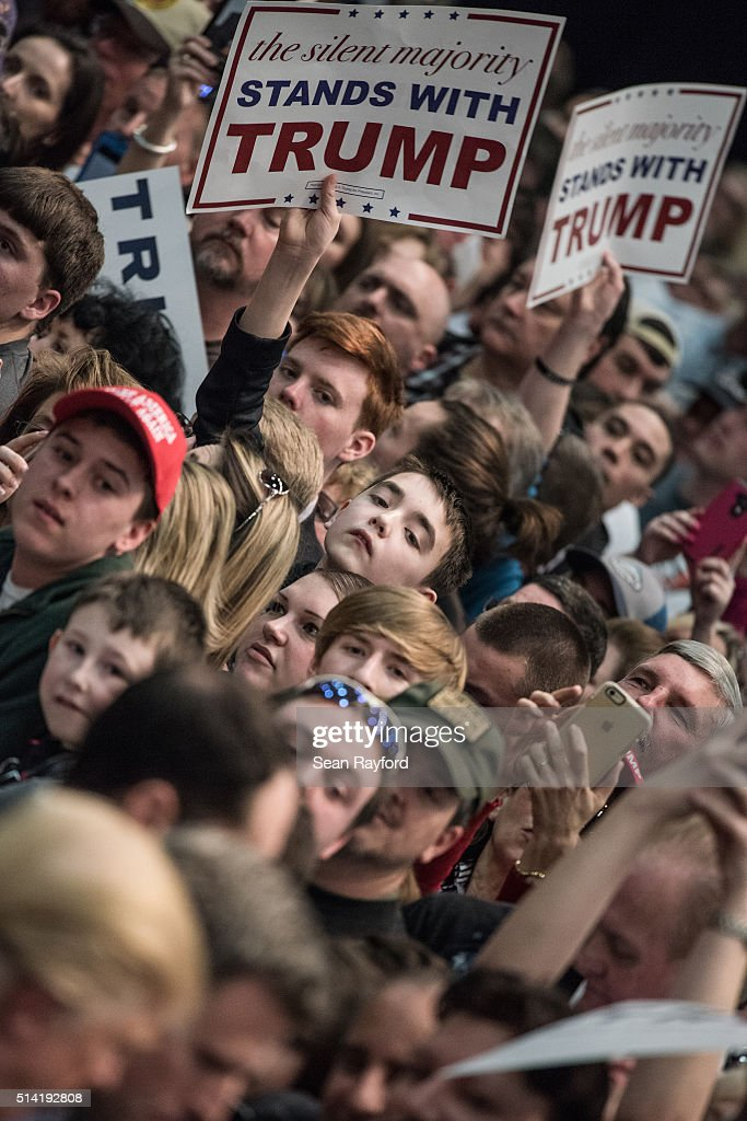 Donald Trump supporters wait for autographs from the Republican presidential candidate at a campaign rally March 7, 2016 in Concord, North Carolina. The North Carolina Republican presidential primary will be held March 15.