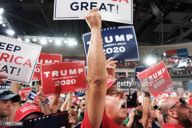 Donald Trump supporters wait for him to speak at a rally in Manchester on August 15 2019 in Manchester New Hampshire The Trump 2020 campaign is...