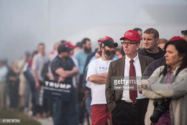 Donald Trump supporters wait in line before a campaign rally for the Republican presidential candidate at LenoirRhyne University March 14 2016 in...