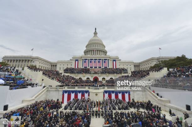 TOPSHOT Donald Trump taking the oath of allegiance during his swearingin ceremony on January 20 2017 at the US Capitol in Washington DC / AFP PHOTO /...