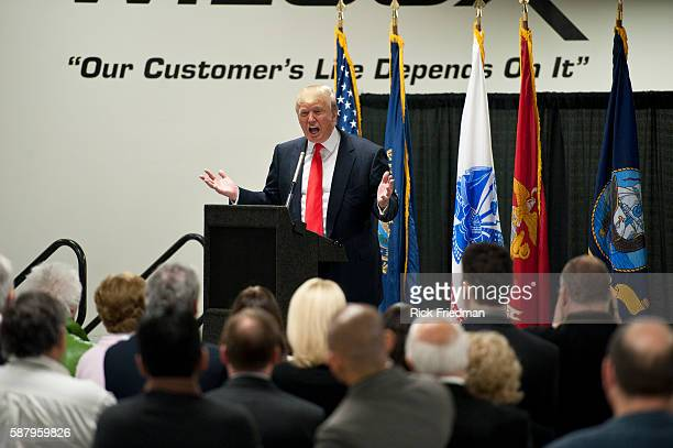 Donald Trump talking to employees of Wilcox Industries a defense contractor in Newington NH on April 27 2011