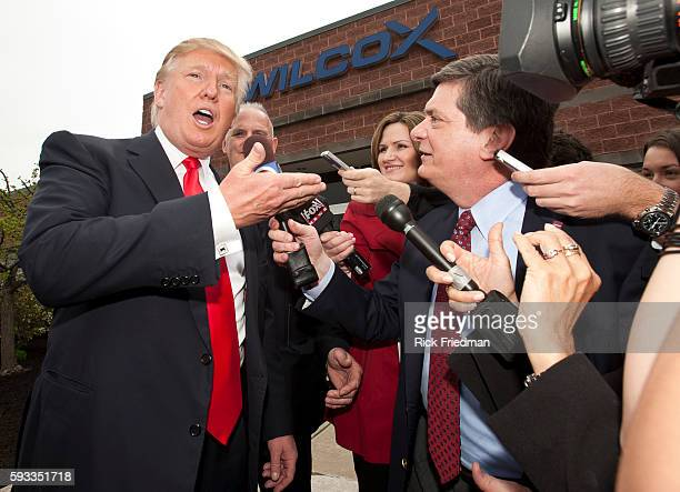Donald Trump talking to the media outside Wilcox Industries a defense contractor in Newington NH on April 27 2011